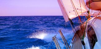 Sailing yacht. Side view of yacht sailing in blue sea with copy space stock photo