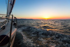 Sailing yacht in the Aegean sea during twilight. Travel. Stock Photos