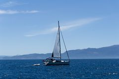 Sailing yacht in the aegean sea, view from the port royalty free stock photos