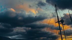 Sailing Yacht Against Dramatic Clouds. Danger Adventure Travel Concept Royalty Free Stock Photos
