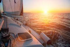 Sailing yacht against sunset. Luxury. Stock Image