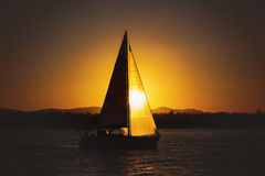 Sailing yacht against sunset. At sunset time Stock Photography