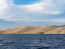 Sailing on a yacht along the landscape of rocky and wavy desert islands in Kornati national park in summer Croatia, Mediterranean. Sea summer Stock Image