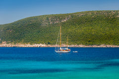 Sailing yacht at anchor in the beautiful Adriatic sea bay Royalty Free Stock Photography