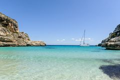 Sailing yacht on anchor in beautiful Mediterranean bay. Sailing yacht in paradise bay on Mallorca island Royalty Free Stock Photography