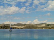 A sailing yacht in a bay Royalty Free Stock Photography