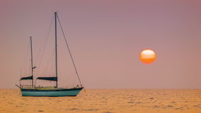 Sailing yacht in the bay. Tropical sunset stock video