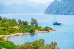 Sailing yacht in the beautiful sea bay Stock Photos
