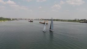 Sailing yacht on big river. Three yachts cruise on river. Yachts race on the lake. stock footage