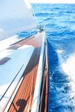 A sailing yacht sailing on the blue sea during sunny wheather Stock Photo