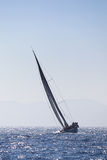 Sailing yacht on blue sea in wind Stock Photography