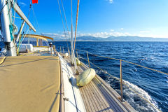 Sailing yacht. On board view of a sailing yacht cruising the aegean sea, Greece Stock Image