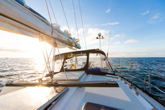 Sailing yacht boat on ocean water against sunset. Travel Concept.  Stock Images