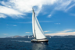 Sailing yacht boat on ocean water, outdoor lifestyle. Luxury royalty free stock photos