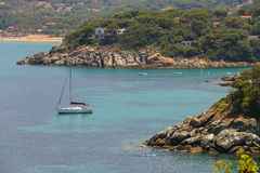 Sailing yacht and boats in Tyrrhenian Sea on Elba Island, Italy royalty free stock images