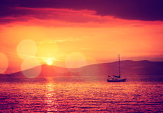 Sailing Yacht in Calm Bay. Sunset Seascape. Royalty Free Stock Photo