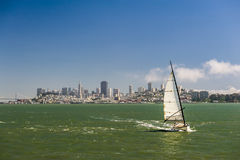 Sailing yacht with city skyline Royalty Free Stock Photo