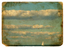 Sailing yacht and clouds. Old postcard. Stock Photo