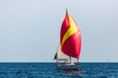 Sailing yacht with colorful bright gennaker in the regatta at Aegean sea. Sailing yacht with colorful bright gennaker in the regatta at Aegean sea, Greece royalty free stock images