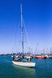 Sailing yacht coming into the harbour Royalty Free Stock Image
