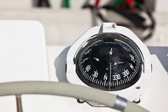 Sailing yacht compass and control wheel Stock Photography