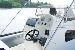 Sailing Yacht control wheel and control panel. royalty free stock image