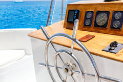 Sailing yacht control wheel and navigation implement. Stock Images