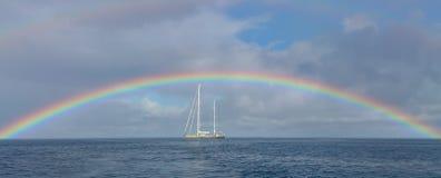Sailing Yacht, Deshaies, Guadeloupe. Sailing yacht under a rainbow, Deshaies, Guadeloupe stock photos