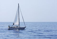 Sailing yacht in an empty sea Stock Images