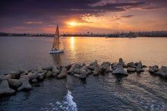 Sailing yacht enters the Varna harbor Stock Photos