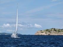 Sailing yacht is floating along croatian riviera. Europe. Croatia. Adriatic sea of  Mediterranean area. September 2012 Royalty Free Stock Image