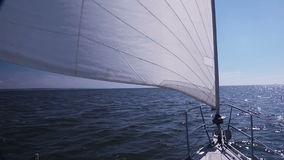 Sailing yacht. Genoa. Sunny weather. Sailing yacht sailing on the sea. Genoa catches light wind