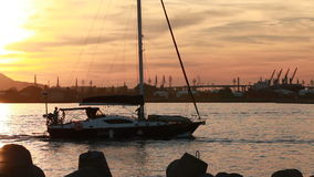 Sailing yacht goes on the Black Sea in harbor of Varna port stock footage