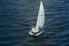 Sailing yacht goes to sea Stock Photo