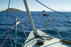 Sailing yacht going to an isolated island Royalty Free Stock Images