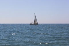 Sailing yacht `Hanya` on the horizon in the Black Sea Stock Images