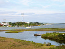 Sailing yacht on the ICW. A sailing yacht transits a curve on the Intracoastal Waterway at North Topsail Beach North Carolina Stock Image