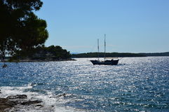 Sailing yacht with island and sea. The sailing yacht  in the sea close to the coast and island in Croatia Royalty Free Stock Photos