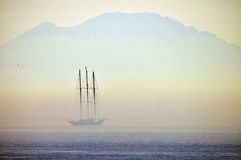 Sailing yacht in a mist Stock Photos