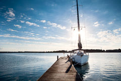 Sailing yacht moored to the pier at sunset Royalty Free Stock Photo