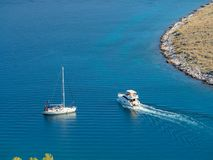 Sailing yacht and motor boat in Croatia, windy summer on the boa Royalty Free Stock Images