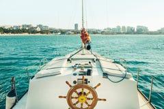 Sailing Yacht Moves Along The Sea Towards The Coast. Travel Vacation Adventure Concept Stock Photos