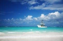 Sailing yacht near beautiful tropical beach Royalty Free Stock Image