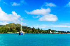 Sailing yacht near coast of Mahe island, Seychelles. Stock Photo