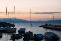 Sailing yacht at the pier at sunset, Cannes Royalty Free Stock Photos