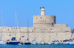 Sailing yacht in the port of Mandraki. Tower of St. Nicholas. Rhodes Island. Greece Royalty Free Stock Photo