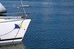 Sailing yacht prow. On blue sea port Stock Images