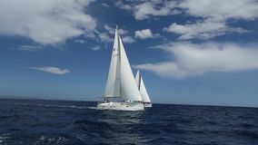 Sailing yacht race. Luxury yachts. Boats in sailing regatta. Sailing ship yachts with white sails.