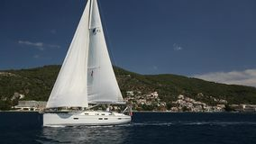 Sailing yacht race. Ship yachts with white sails in the open Sea. stock footage