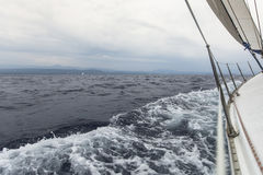 Sailing yacht on the race in a stormy sea. Sailing. Stock Image